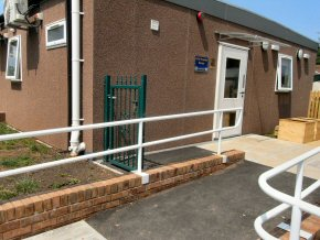 Disabled access to classroom with handrails